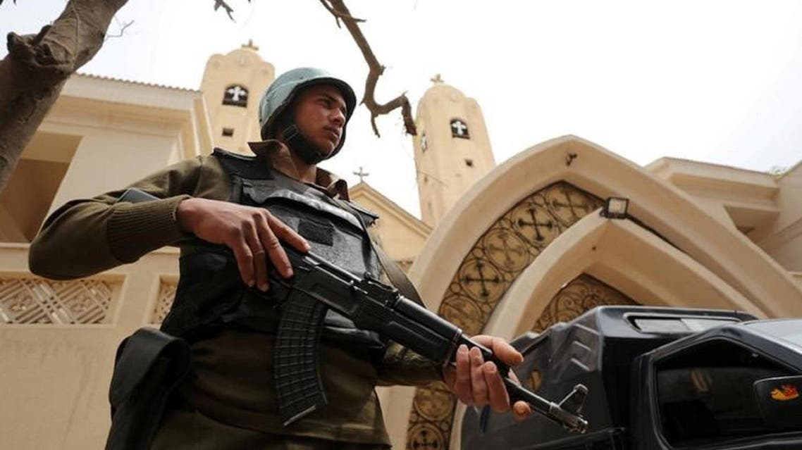 A policeman stands in front of a church in Tanta, Egypt. (Reuters)