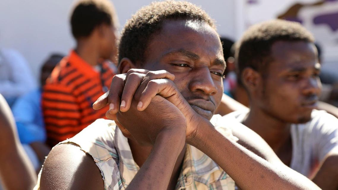 Sudanese migrants sit at a detention center before their voluntary return to their country, in Tripoli, Libya, on September 14, 2017. (Reuters)