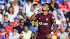 Paulinho saves Barca against plucky Getafe
