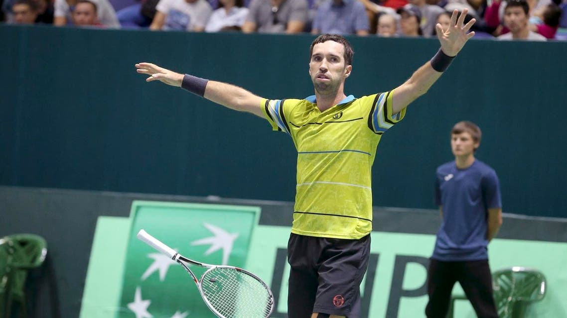 azakhstan's Mikhail Kukushkin celebrates his victory over Argentina's Diego Schwartzman Davis Cup after the play-off tennis match in Astana, on Sept. 17, 2017. (AP)