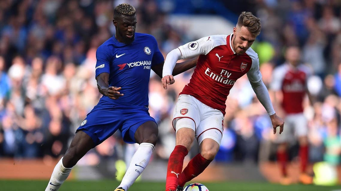 Arsenal's Welsh midfielder Aaron Ramsey (R) vies with Chelsea's French midfielder Tiemoue Bakayoko during the English Premier League football match between Chelsea and Arsenal at Stamford Bridge in London on September 17, 2017. (AFP)