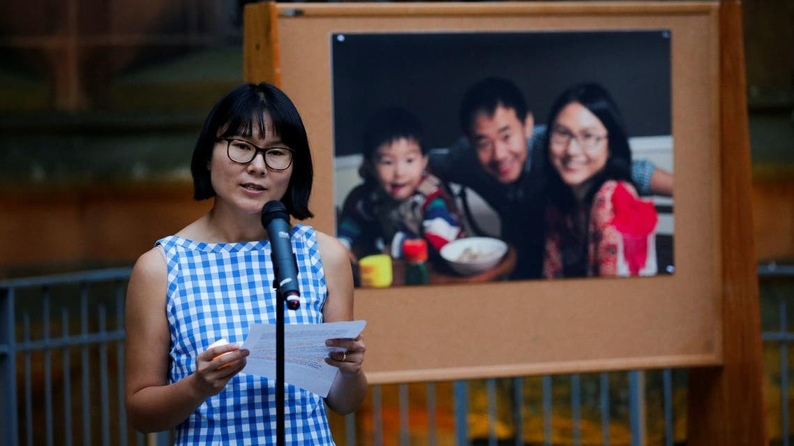 Hua Qu speaks to people as they attend a vigil for Xiyue Wang at Princeton University, New Jersey, US, on September 15, 2017. (Reuters)