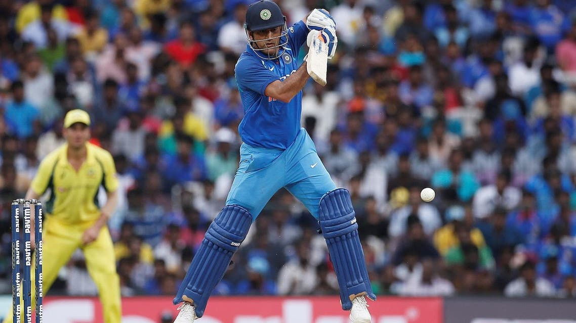 India's Mahendra Singh Dhoni plays a shot in the first One Day International match in Chennai, India, against Australia. (Reuters)
