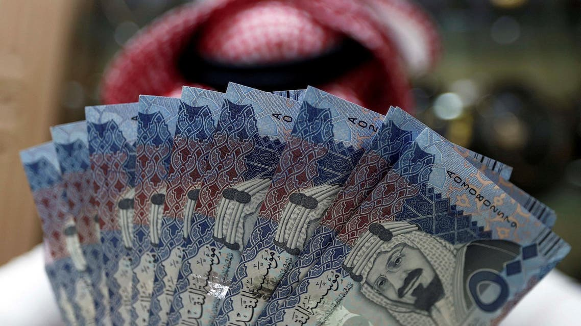 A Saudi money changer displays Saudi Riyal banknotes at a currency exchange shop in Riyadh, Saudi Arabia July 27, 2017. (Faisal Nasser, Reuters)