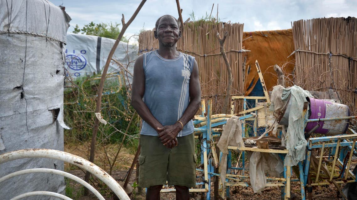 Ramadan Wani, who hasn't seen his family in the six years he has been stranded at a displaced persons' camp, stands outside his makeshift house in Payuer, South Sudan Monday, Aug. 21, 2017. (ap)