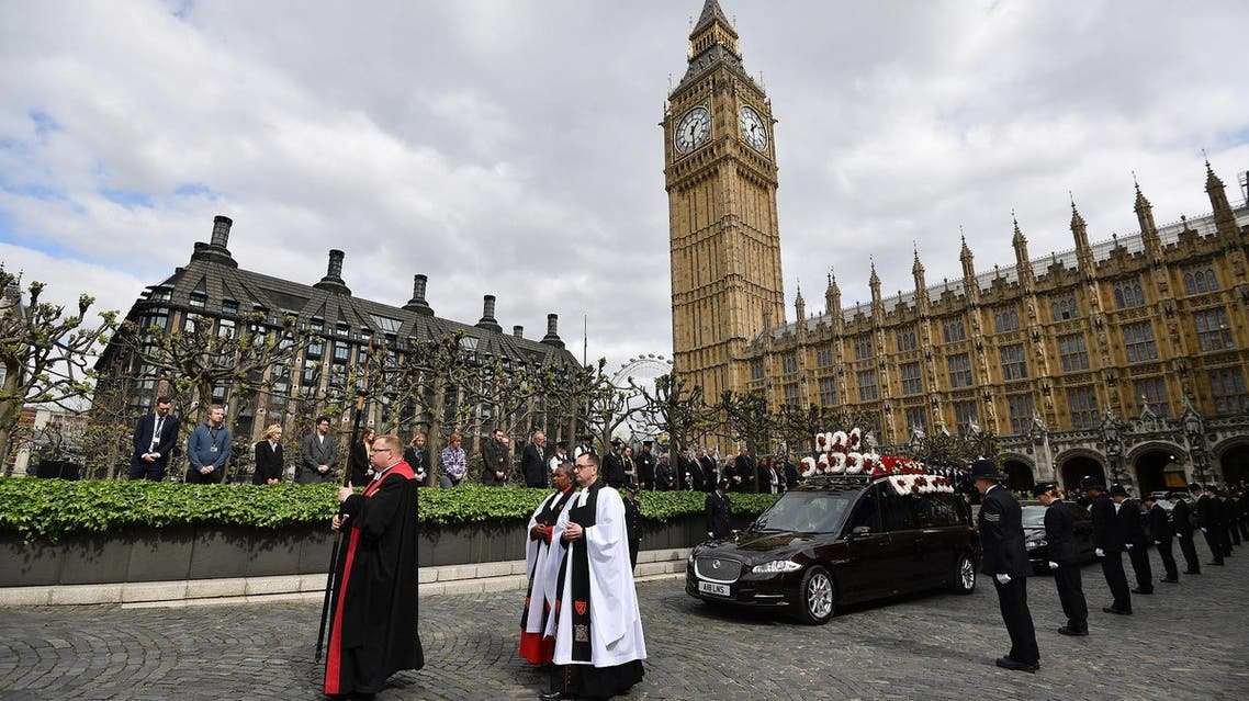 The hearse carrying coffin of PC Keith Palmer, officer killed in the March 22 Westminster terror attack, heading to his funeral in central London on April 10, 2017. (Reuters)