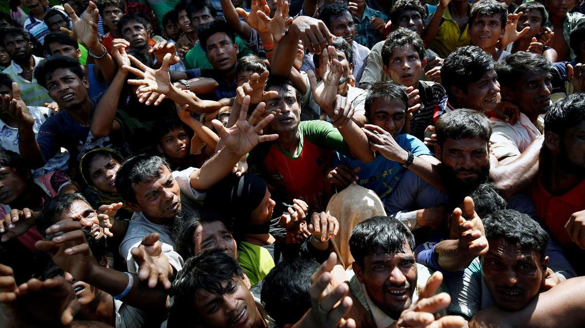 Rohingya refugees stretch their hand for relief supplies given by local people in Cox's Bazar, Bangladesh September 16, 2017. (Reuters)