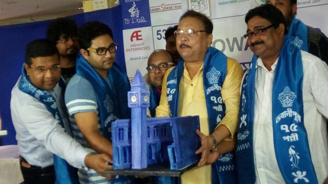 Madan Mitra displays a miniature Big Ben while announcing that replicas of London's landmarks will add colour to Durga Puja this year. (Supplied)