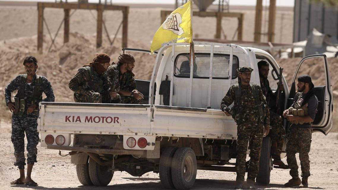 Fighters from Deir al-Zor military council which fights under the Syrian Democratic Forces (SDF) sit on a back of a truck in the village of Abu Fas, Hasaka province, Syria September 9, 2017. reuters