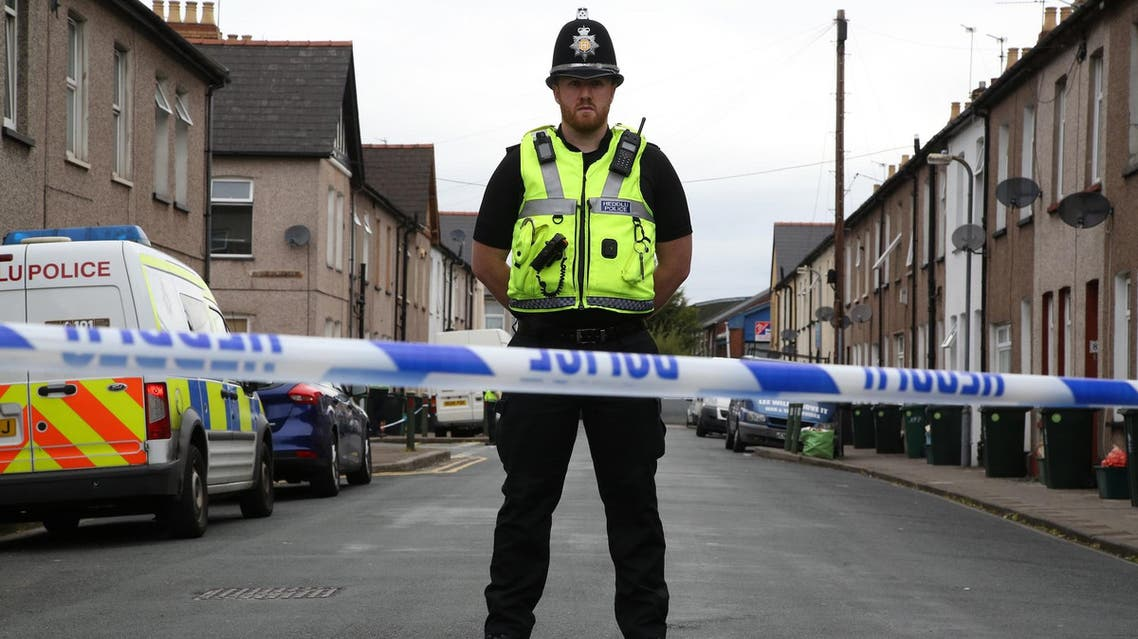 A police officer stands guard at a police cordon near to a house in Newport, south Wales, on September 20, 2017, as they continue their investigations into the September 15 terror attack. (AFP)