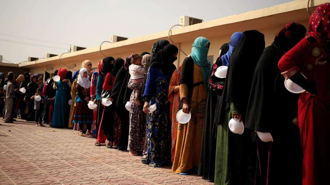 Women who recently fled ISIS stronghold of Hawija queue to receive food at a camp on the outskirts of Erbil, Iraq, October 19, 2016. (Reuters)