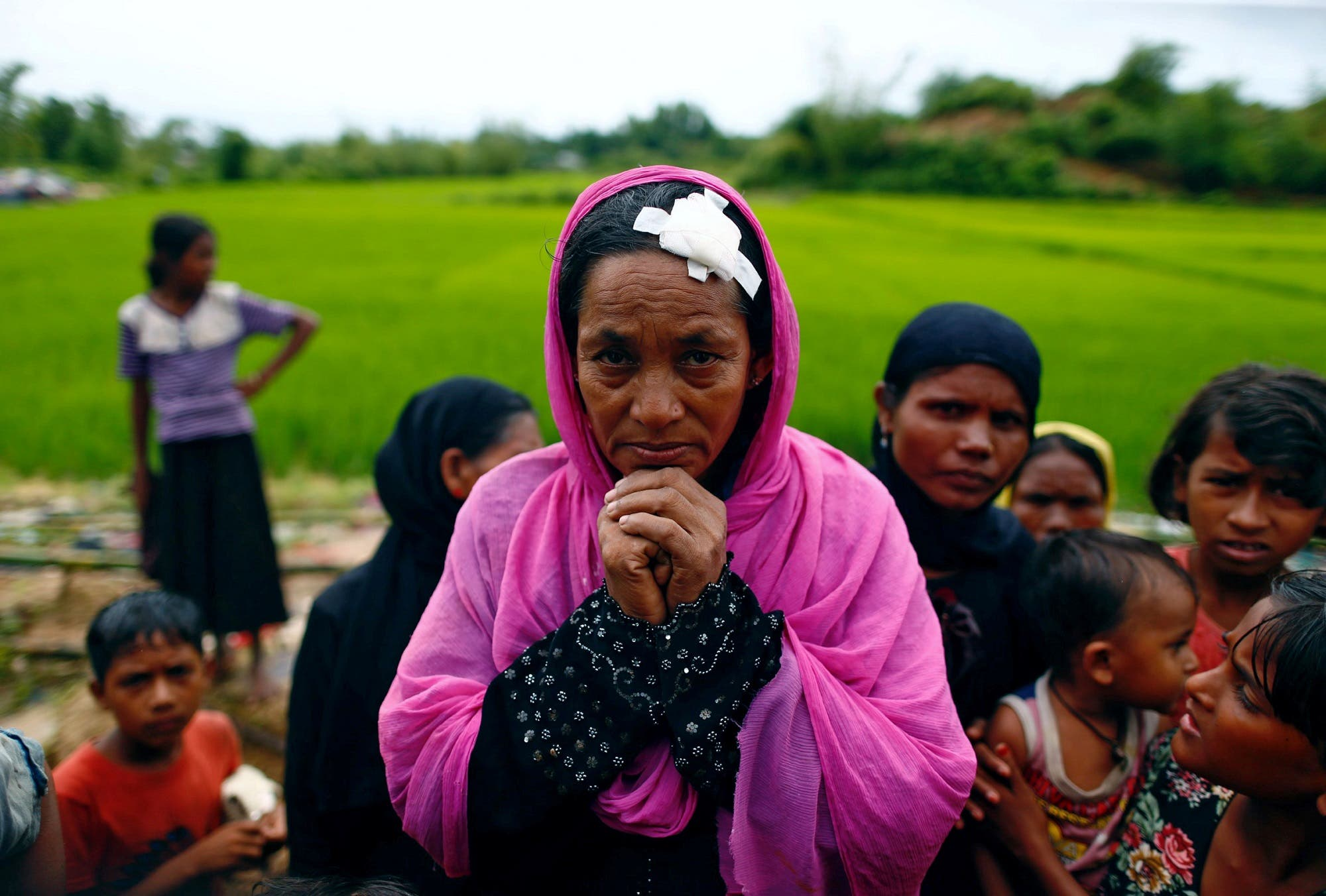 Noorjehan, 40, who said she was injured by a shrapnel when Myanmar army fired at her house, waits for aid in Cox's Bazar, Bangladesh September 20, 2017. (Reuters)