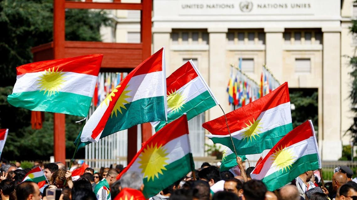People wave flags at a demonstration in support of the referendum for independence of Kurdish Iraq in front of the Palais des Nations in Geneva, Switzerland. (Reuters)