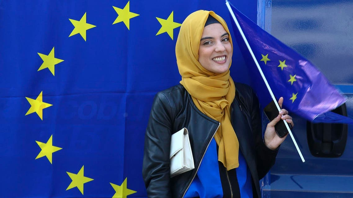 A Muslim woman holds a European flag during a pro-EU demonstration on the 60th anniversary of the Treaty of Rome, in Rome, on March 25, 2017. (Reuters)
