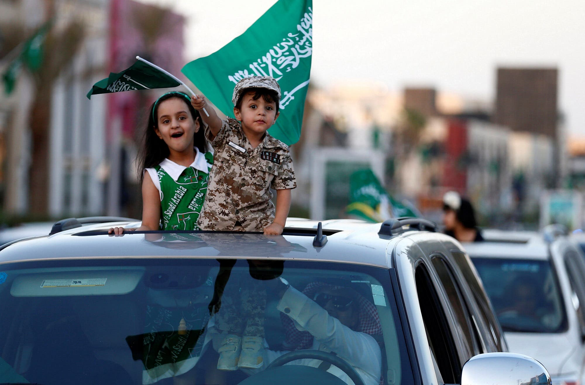 Saudi children celebrating the country's National Day on a street in Riyadh on September 23, 2016. (Reuters)