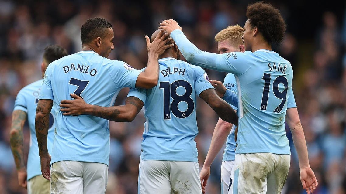 Manchester City's English midfielder Fabian Delph (C) celebrates with teammates after scoring their fifth goal during the English Premier League football match between Manchester City and Crystal Palace at the Etihad Stadium in Manchester, north west England, on September 23, 2017. (AFP)