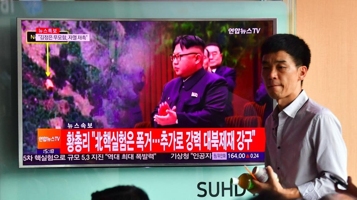 """People watch a television news report, showing file footage of North Korean leader Kim Jong-Un, at a railway station in Seoul on September 9, 2016. North Korea claimed September 9 it has successfully tested a nuclear warhead that could be mounted on a missile, drawing condemnation from the South over the """"maniacal recklessness"""" of young ruler Kim Jong-Un. (AFP)"""