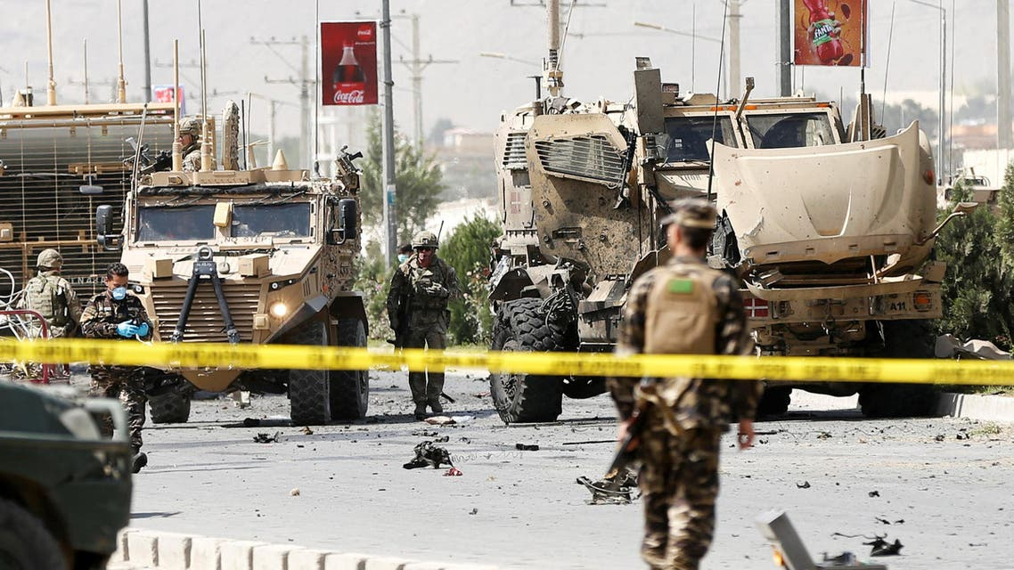 NATO troops investigate a Danish convoy at the site of a car bomb attack in Kabul, Afghanistan. September 24, 2017. (Reuters)