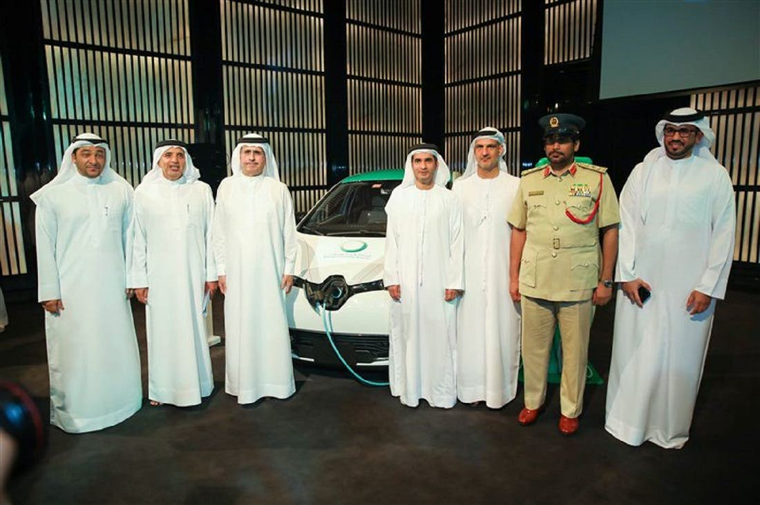 Dubai officials with electric car and charging station during a press conference in Dubai. (Supplied)
