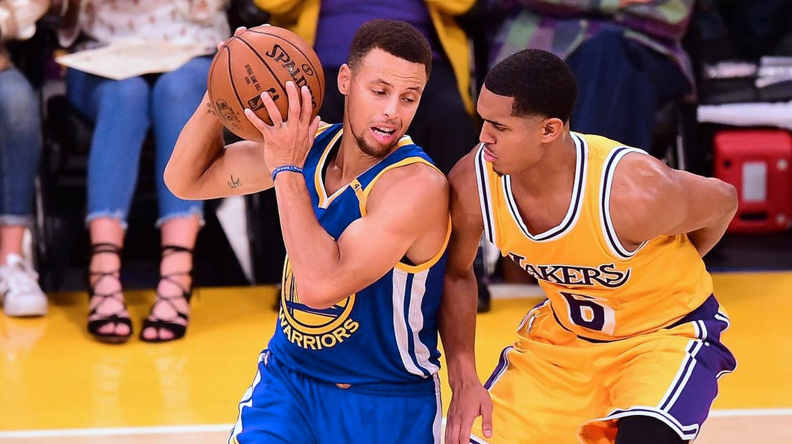 """(FILES) This file photo taken on November 4, 2016 shows Stephen Curry of the Golden State Warriors looking to pass under pressure from Jordan Clarkson of Los Angeles Lakers in their NBA game in Los Angeles, California. President Donald Trump triggered a backlash from the US professional sports world on September 23, 2017, withdrawing a White House invitation to the NBA champion Golden State Warriors after condemning NFL players protesting the national anthem. A day after Trump had decried activist National Football League stars as """"sons of bitches"""" who should be fired for kneeling or sitting during renditions of The Stars and Stripes, the US leader turned his ire to basketball's reigning champions and star player Stephen Curry. (AFP)"""
