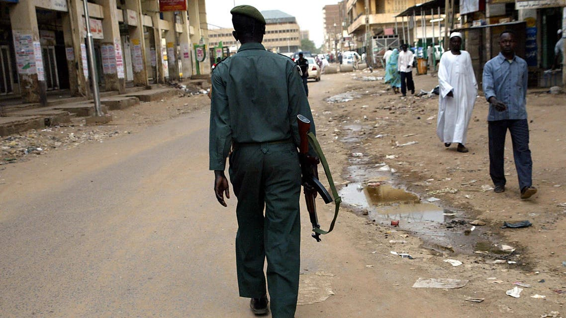 An armed policeman patrols the streets of the Sudanese capital that was largely deserted and calm 06 August 2005 as authorities declared a public holiday to allow the people to follow the funeral ceremony of First Vice President John Garang whose death in a helicopter crash triggered days of deadly riots in Khartoum. AFP