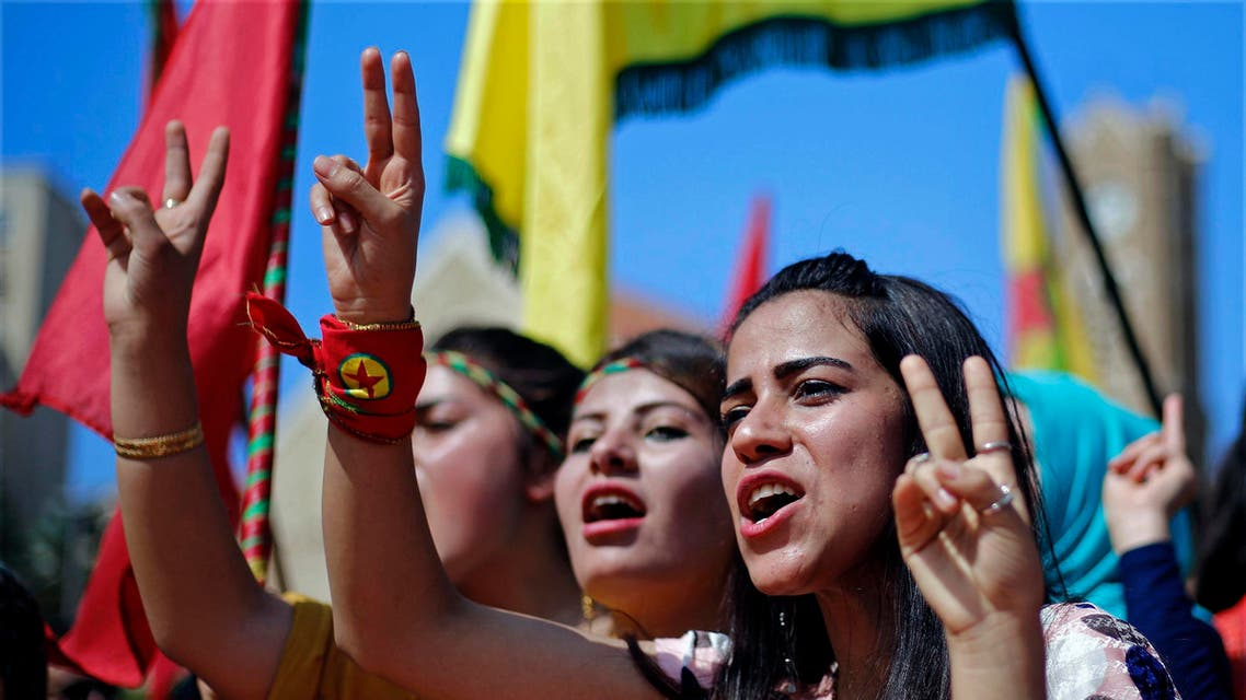 Supporters of the Kurdistan Workers' Party, known as the PKK, chant slogans as they flash victory signs during a demonstration in Lebanon. (AP)