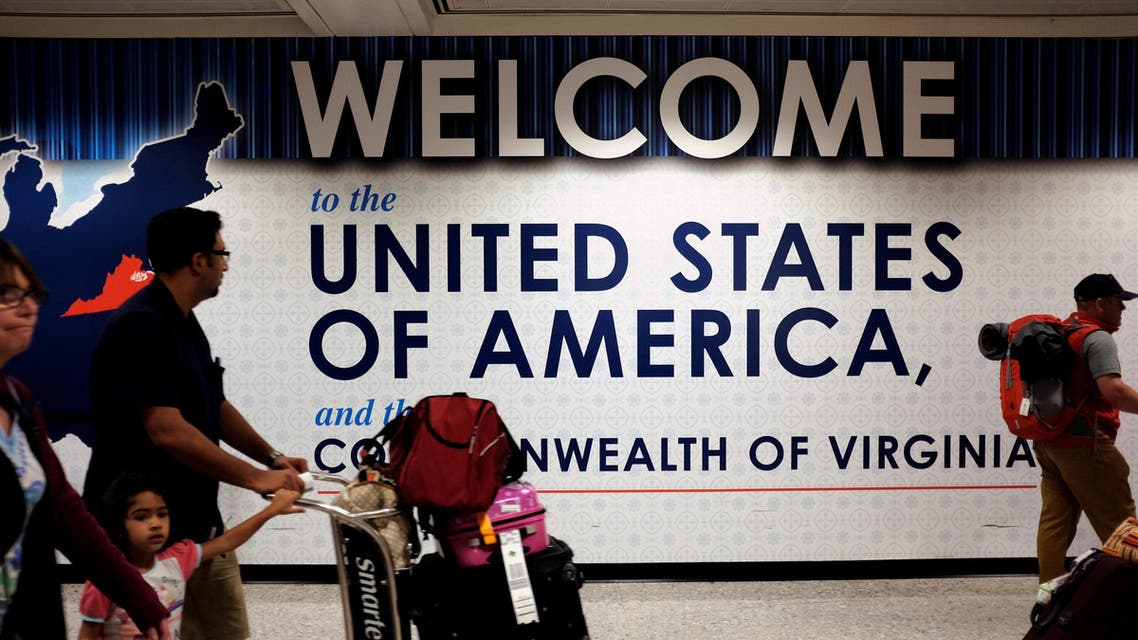 A family exits after clearing immigration and customs at Dulles International Airport in Dulles, Virginia, U.S. September 24, 2017. REUTERS/James Lawler Duggan