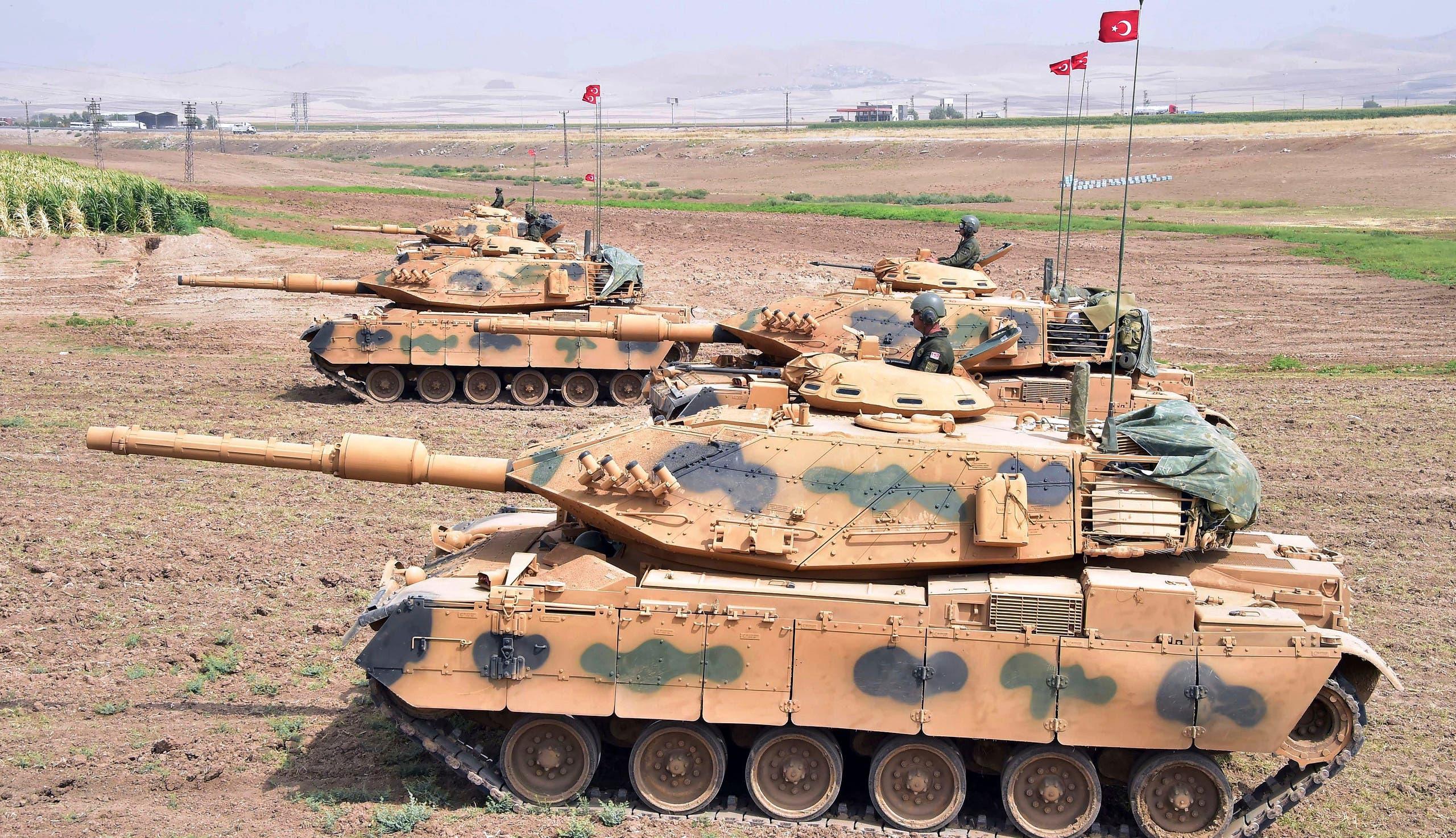 In this photo taken Saturday, Sept. 23, 2017, Turkish army tanks move during maneuvers in Silopi, near Habur border gate with Iraq, southeastern Turkey. (AP)