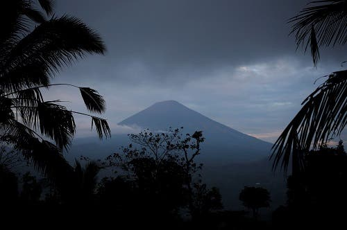 A view of Mount Agung, a volcano on the highest alert level, from Karangasem Regency, on the resort island of Bali, Indonesia, September 24, 2017. (Reuters)
