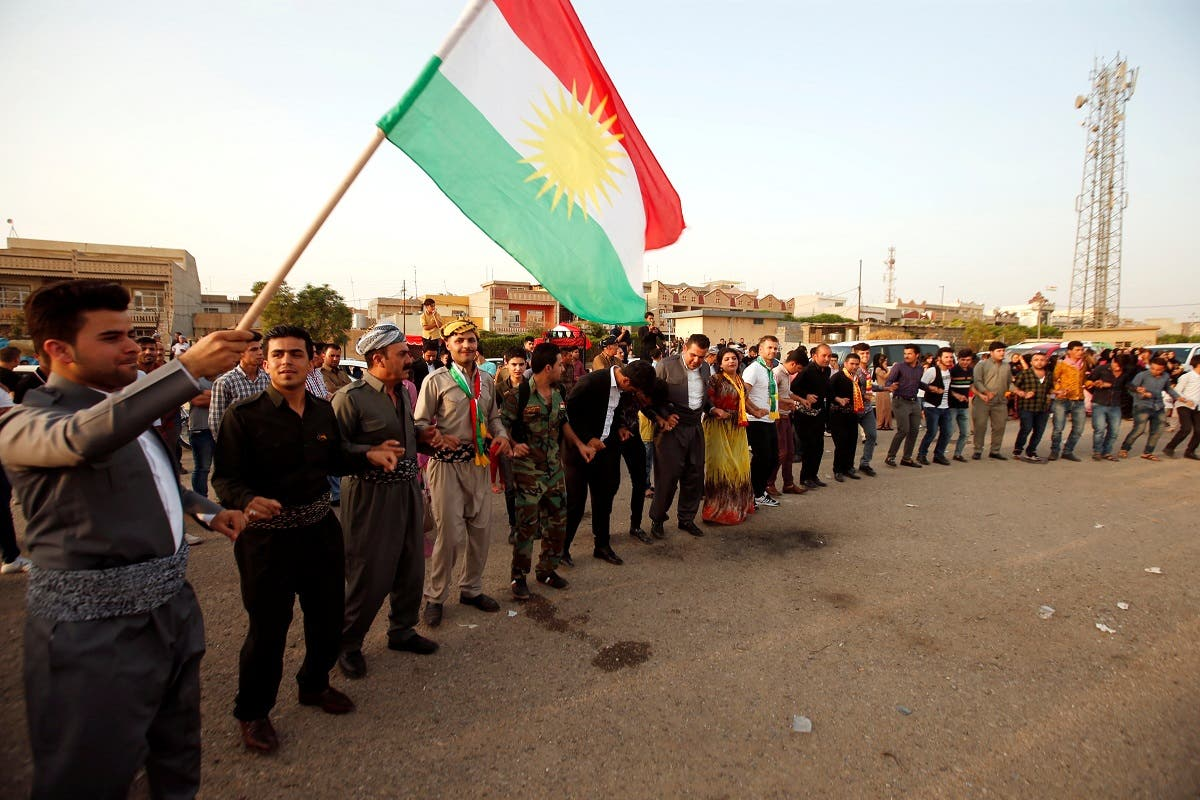 Kurds celebrate during their independence referendum in Erbil. (Reuters)