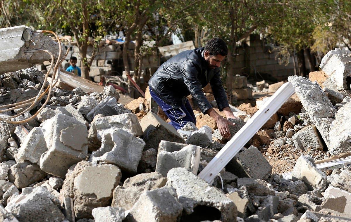 An Arab man works on rebuilding his destroyed house in Kirkuk's Huzeiran neighborhood, Iraq. (AP)