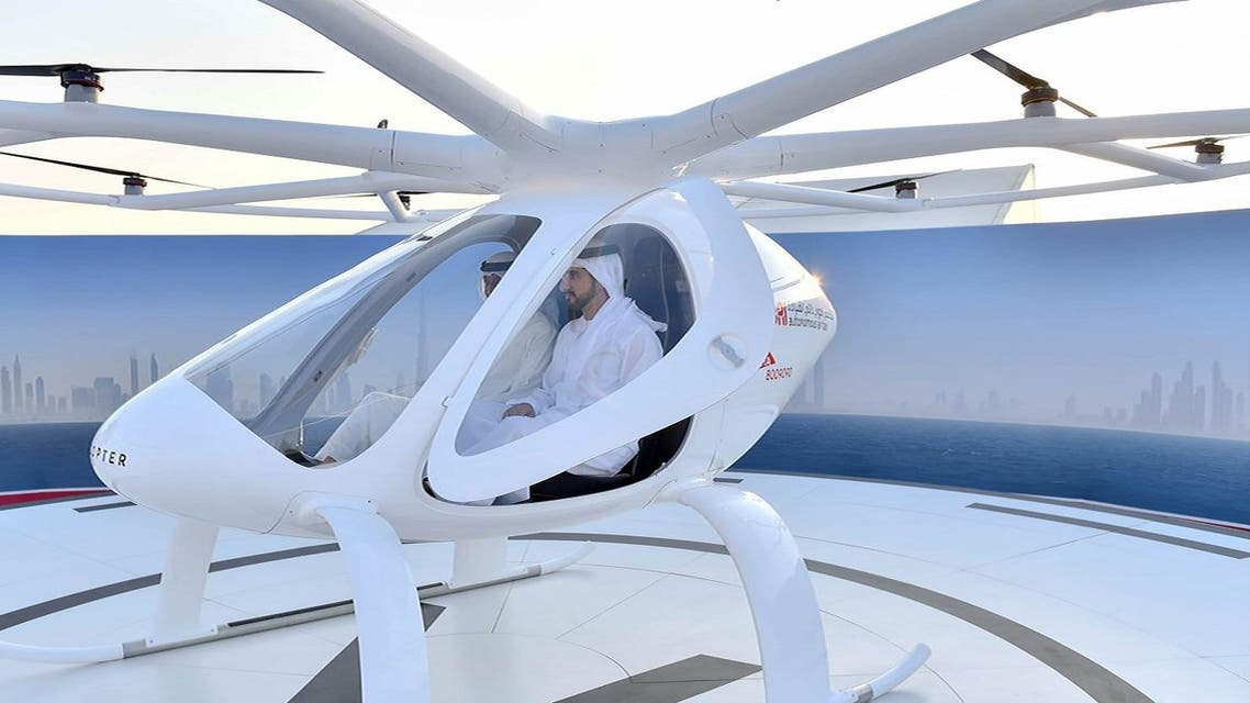 "Sheikh Hamdan bin Mohammed bin Rashid al-Maktoum (C), Crown Prince of Dubai, sitting in a prototype two-seater air taxi during a ""concept"" flight in Dubai. (AFP)"
