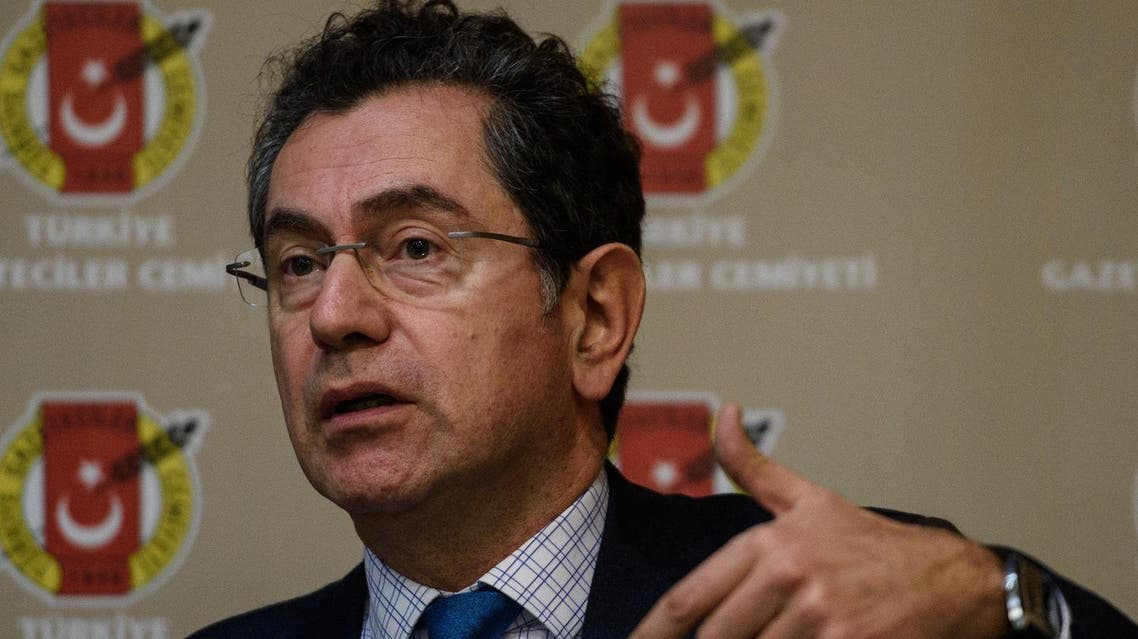 Kadri Gursel, Freedom for Jornalist Platform spokesman gestures during a press conference on December 1, 2015 in Istanbul. A court in Istanbul charged two journalists from the opposition Cumhuriyet newspaper with spying after they alleged Turkey's secret services had sent arms to Islamist rebels in Syria, Turkish media reported. (AFP)