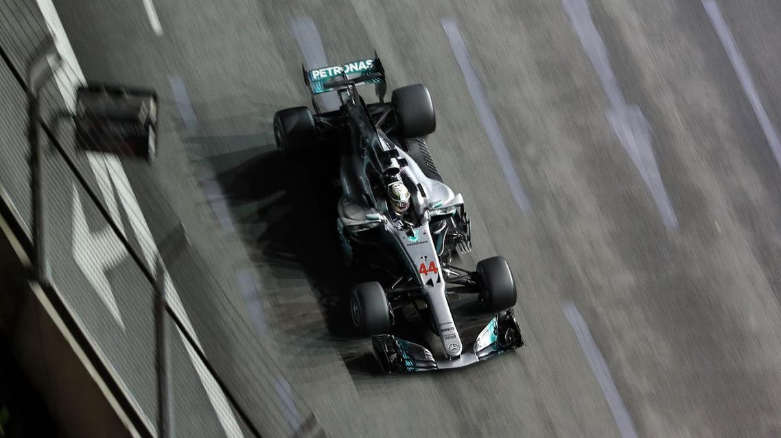 Mercedes' British driver Lewis Hamilton drives during the Formula One Singapore Grand Prix in Singapore on September 17, 2017. (AFP)