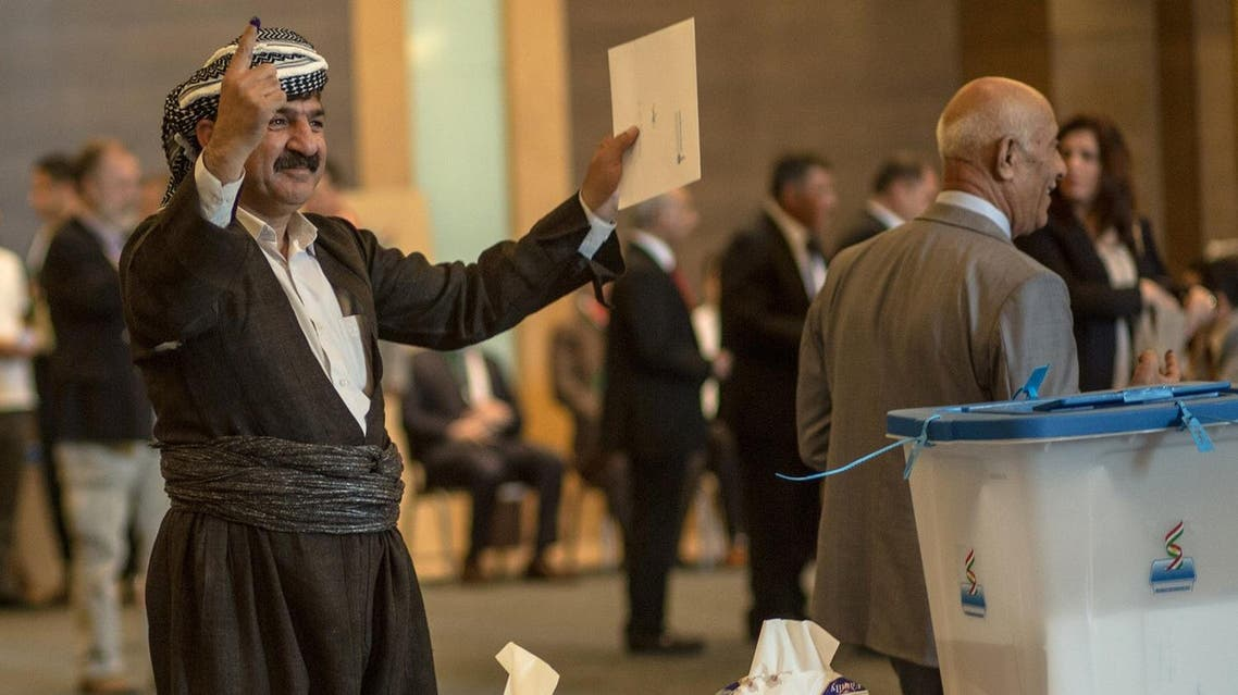 An officials of Kurdistan Regional Government (KRG) shows his ink-stained finger after casting his vote in the Kurdish independence referendum at a hotel in Arbil on September 25, 2017. Iraqi Kurds voted in an independence referendum, defying warnings from Baghdad and their neighbours in a historic step towards a national dream. (AFP)