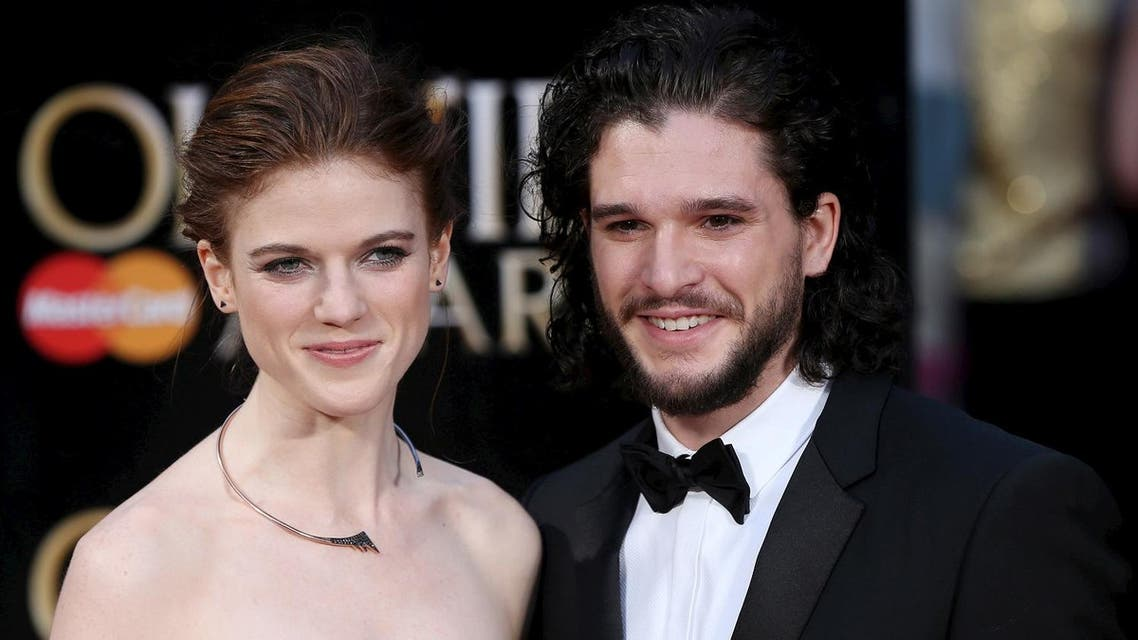 British actors Kit Harington (R) and Rose Leslie pose for photographers as they arrive at the Olivier Awards at the Royal Opera House in London, Britain, April 3, 2016. (Reuters)
