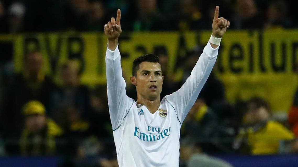 Real Madrid's forward from Portugal Cristiano Ronaldo celebrates scoring during the UEFA Champions League Group H football match BVB Borussia Dortmund v Real Madrid in Dortmund, western Germany on September 26, 2017. (AFP)