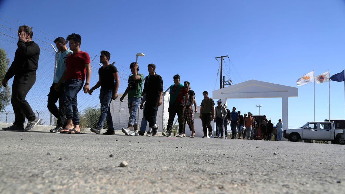 Migrants from Syria walk towards a refugee camp at Kokkinotrimithia, outside of the capital Nicosia, in the eastern Mediterranean island of Cyprus, on Sunday, Sept. 10, 2017. AP