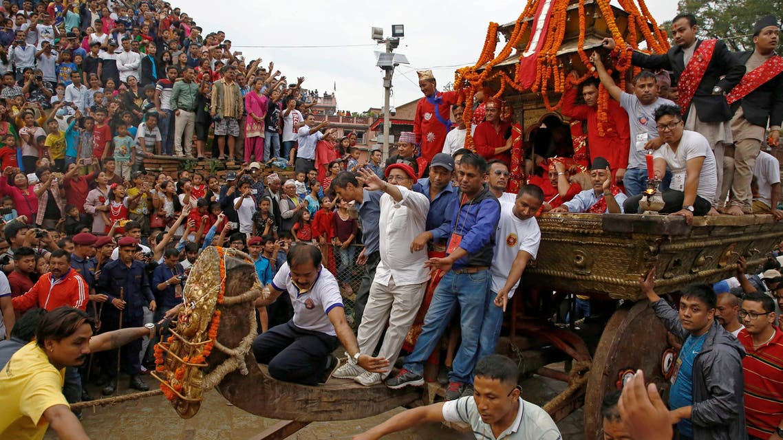 Devotees pull the chariot of Nepal's Living Goddess Kumari during the annual festival of Indra Jatra celebrated to worship Indra, Kumari and other deities and to mark the end of the monsoon season in Kathmandu, Nepal, September 5, 2017. reuters