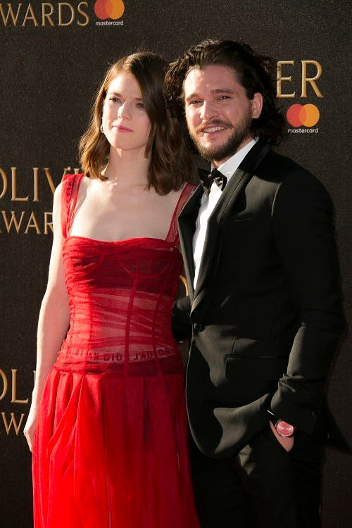 Kit Harington, right, and Rose Leslie pose for photographers as they arrive for the Olivier Awards at the Royal Albert Hall in central London, Sunday, April 9, 2017. AP