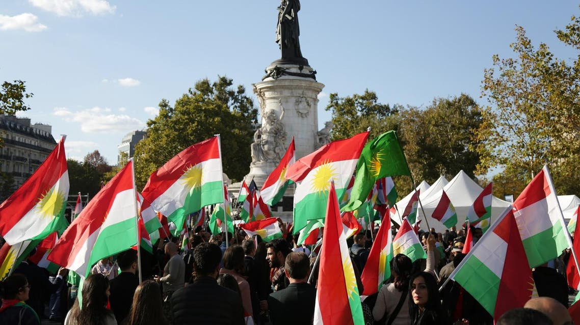 "People hold Kurdish flags on September 22, 2017, on the Place de la Republique in Paris, as they attend a gathering in support of a ""yes"" vote ahead of an independence referendum for Iraqi Kurdistan due to be held on September 25. Iraq's Kurds have faced mounting international pressure, including from neighbouring Iran and Turkey, to call off the referendum that the UN Security Council has warned was potentially destabilising. (AFP)"