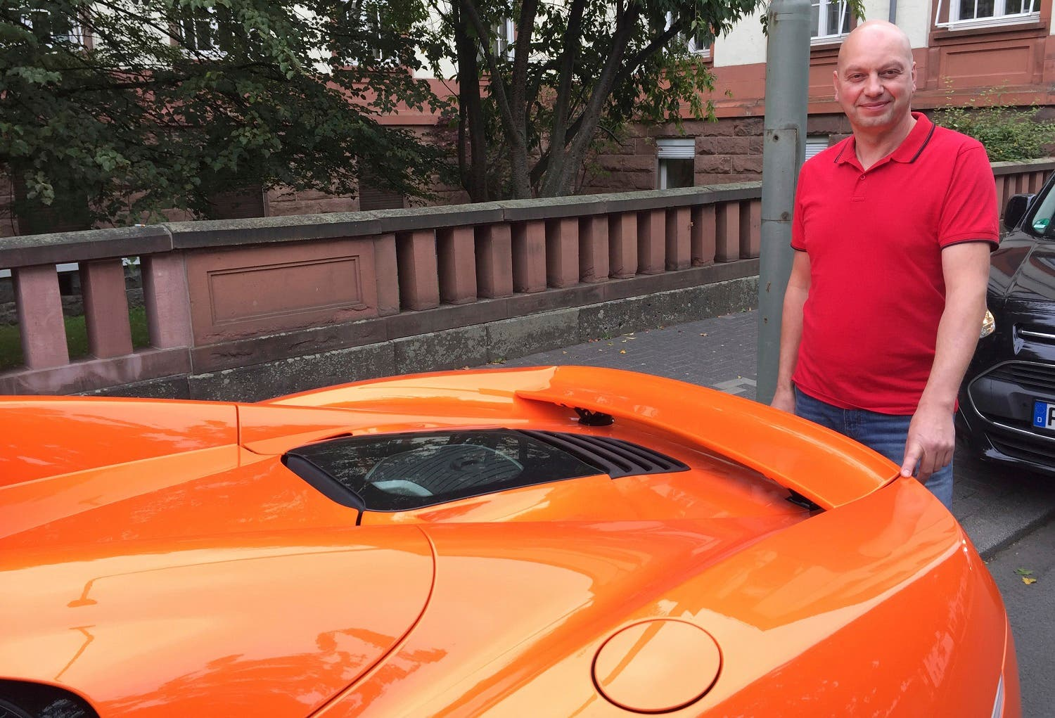 Markus Zahn stands near his sports car in Giessen, Germany, on Sept. 28, 2017. (AP)