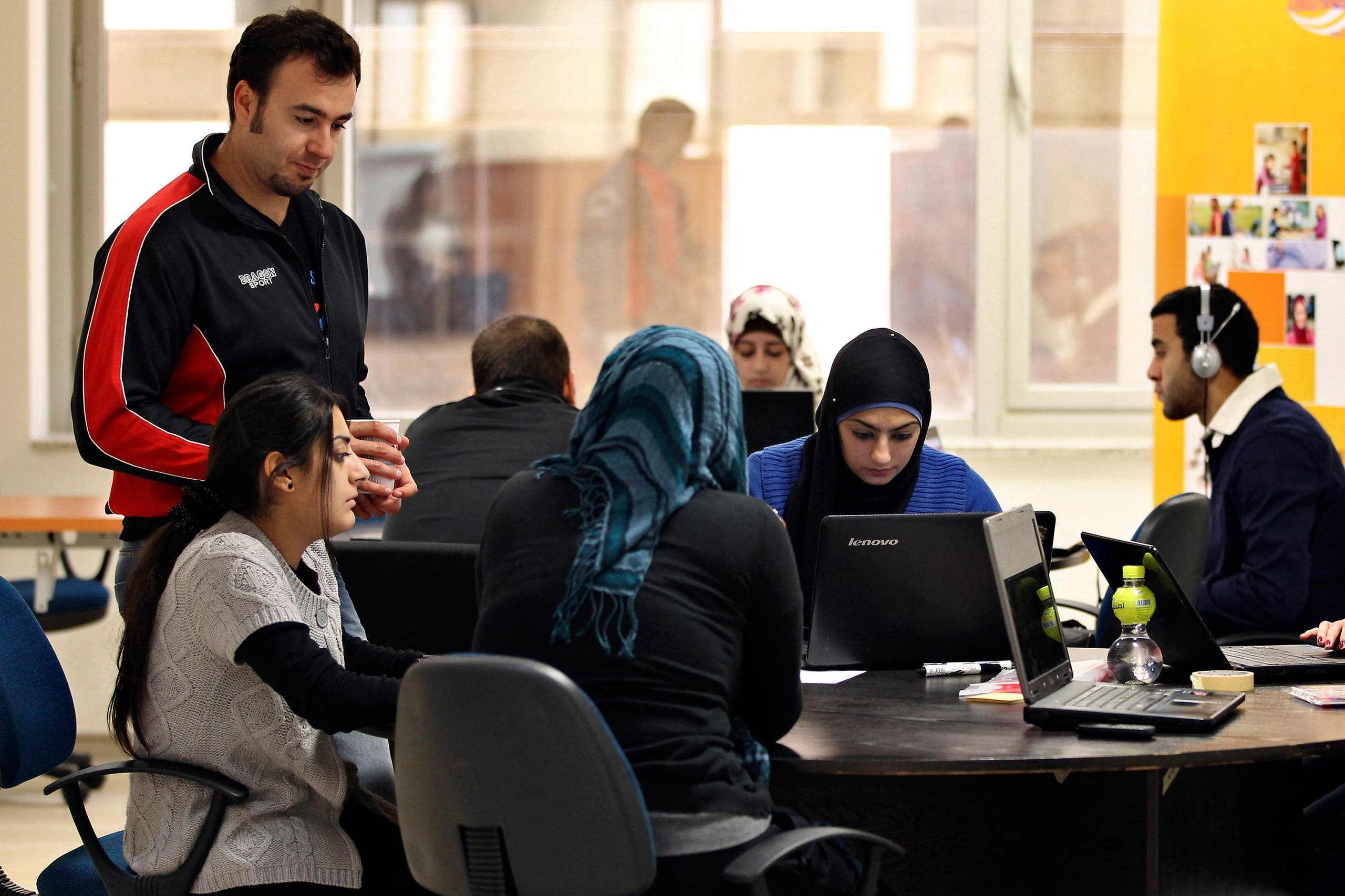 Young entrepreneurs work at the Amman-based Oasis 500, a seed investment firm which finances start-up firms in the region's IT sector, on November 2, 2011. (Reuters)