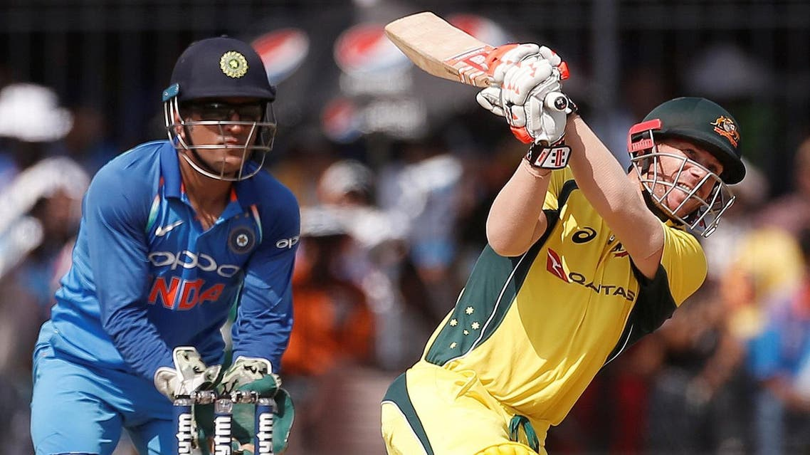 David Warner plays a shot as India's wicket-keeper Mahendra Singh Dhoni (left) looks on. (Reuters)
