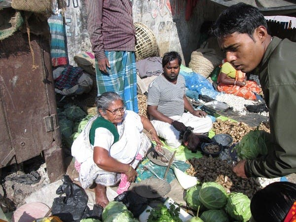 Mistry selling vegetables on the pavement to raise funds for Humanity Hospital. (Supplied)