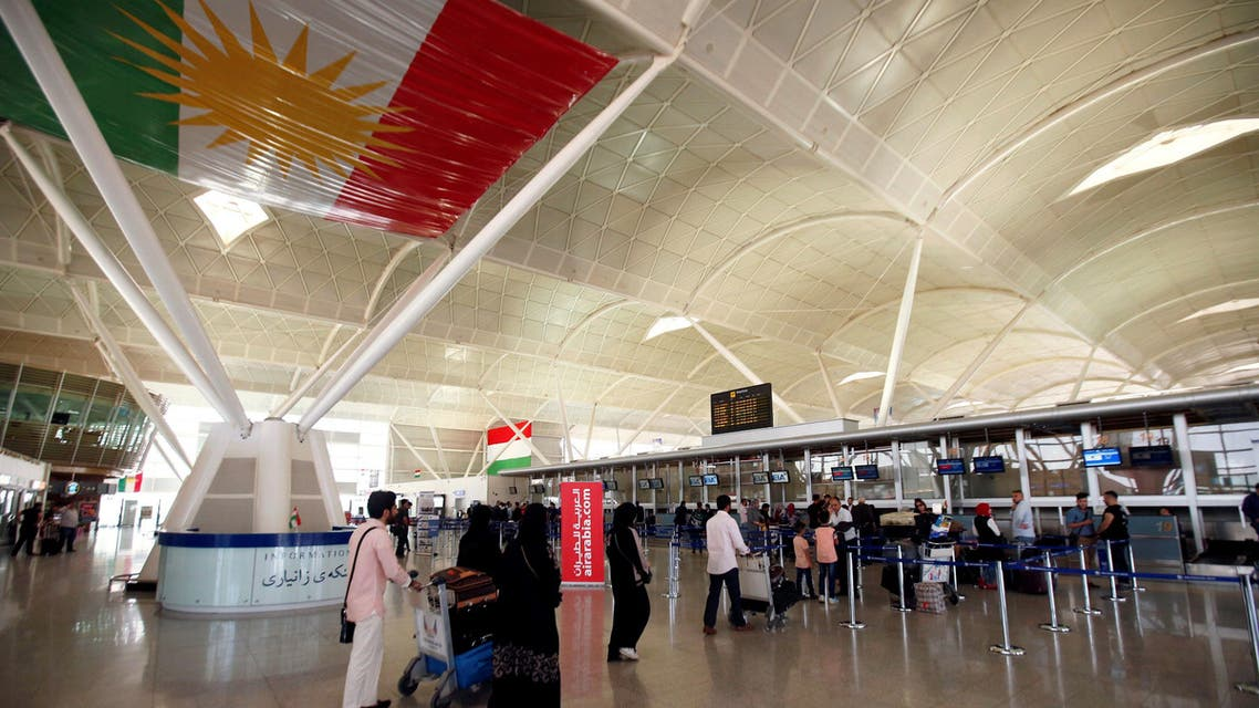 Passengers walk towards the check-in counters at Erbil International Airport, Iraq September 27, 2017. (Reuters)