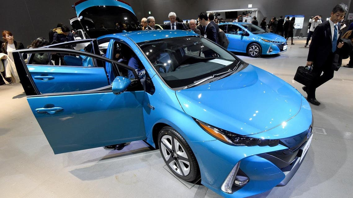 ournalists look at the redesigned Toyota Motor Prius PHV (plug-in hybrid vehicle) during a press conference in Tokyo on February 15, 2017.  (AFP)