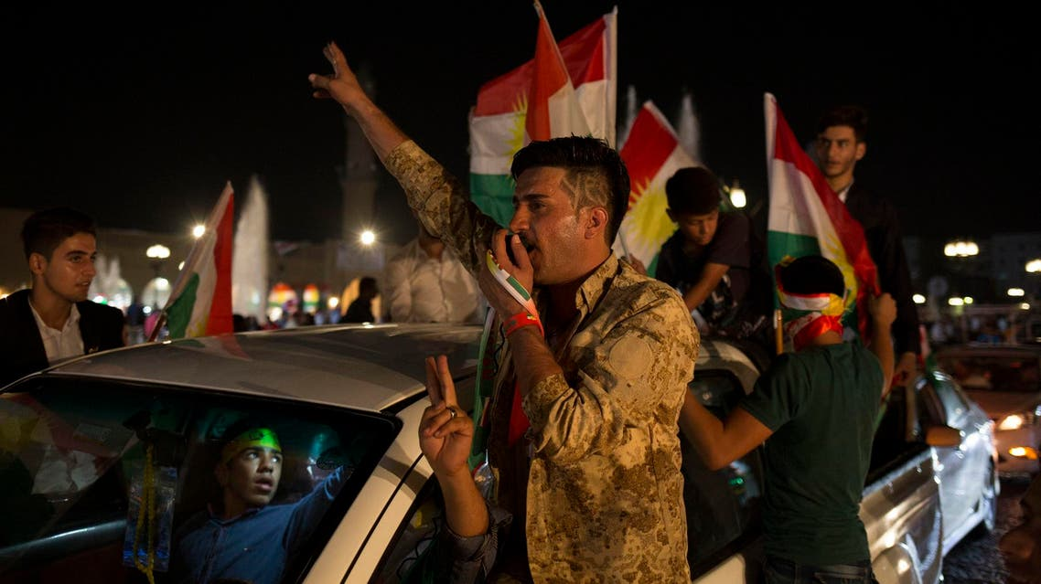 A man with 'yes' shaved into his hair chants through a speaker in the streets of Erbil after polling stations closed on Monday, Sept. 25, 2017. (AP)