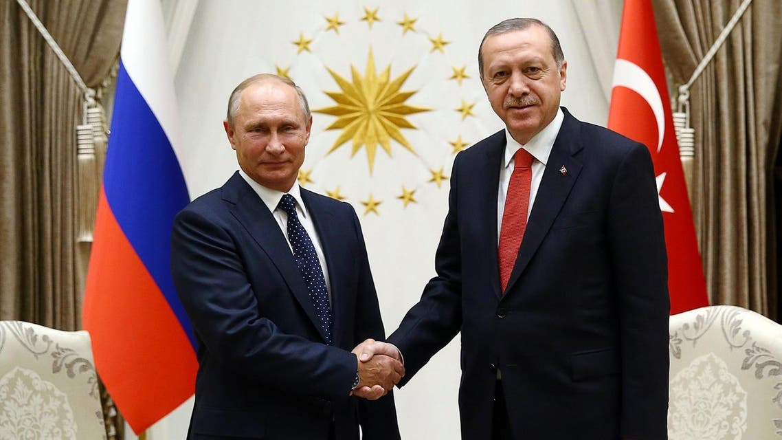 President of Russia, Vladimir Putin (L) shaking hands with Turkish President Recep Tayyip Erdogan (R) at Presidential Complex in Ankara during an official visit. (AFP)