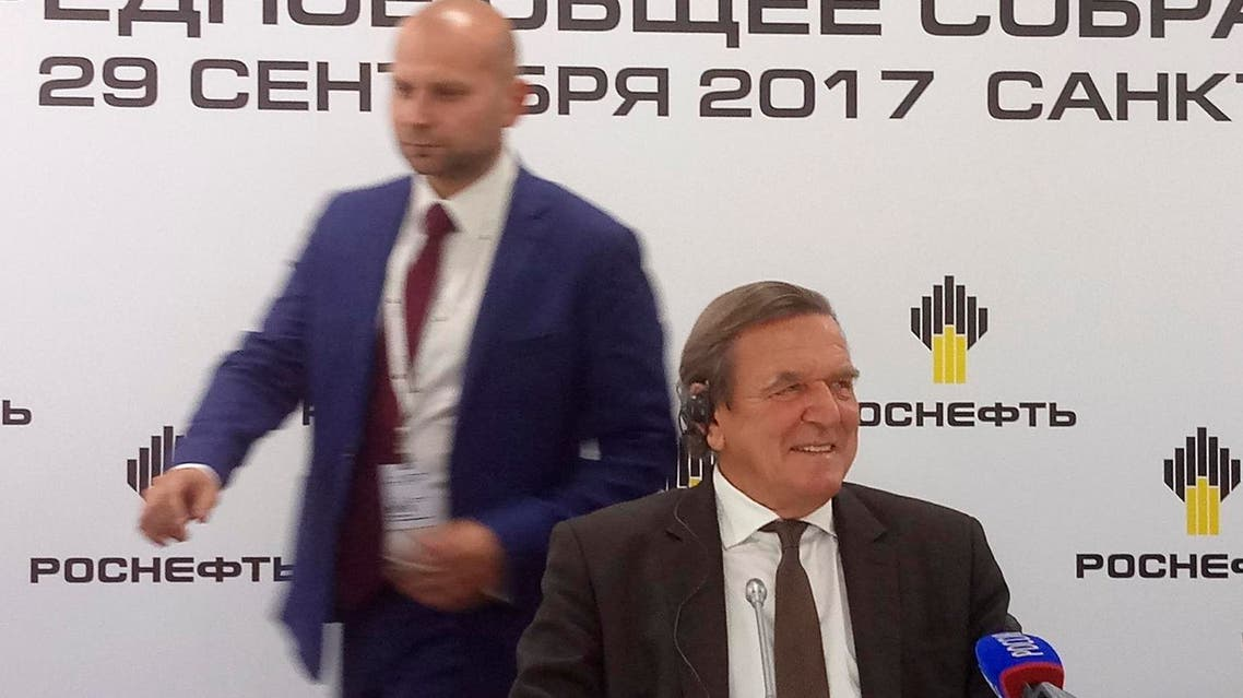 Gerhard Schroeder (right), newly elected Chairman of Russia's biggest oil producer Rosneft, attends a news briefing in St. Petersburg, on September 29, 2017. (Reuters)